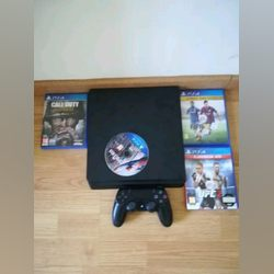 PlayStation 4 SLIM 1 TB + 4 jogos foto 1
