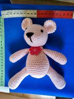 Boneco em lã feito à mão foto 1