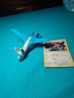 Brinquedo Pokémon + carta