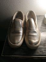 Sapatilhas douradas foto 1