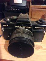 Máquina fotográfica de rolo a trabalhar , foto 1