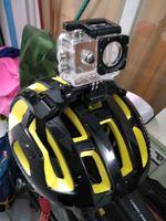 Câmara digital + capacete de ciclismo foto 1