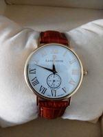 Relógio de Ouro da mascote com um pequena safira é foto 1