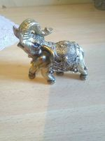 Elefante decorativo dourado foto 1