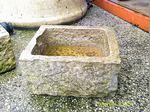 Uma pia quadrada em pedra foto 1