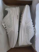 Sapatilhas brancas Nike foto 1