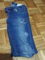 Calça jeans rasgada foto 1