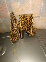 Sapato castanho de tigre foto 1