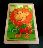Puzzle Madeira Leão Colorido foto 1