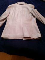 Casaco azul bebê em pele foto 1