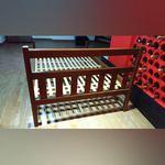 Cama pessoa e meia e mesas de cabeceira. foto 1