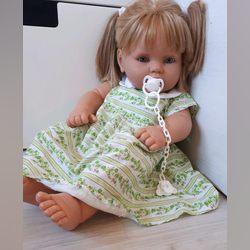 Boneca loira de olhos azuis funciona muito bem! foto 1