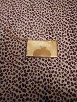 Bolsa para casamento da DKNY dourada foto 1