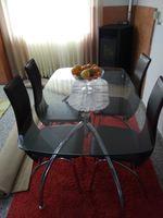 Mesa de vidro e cadeiras foto 1