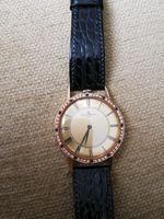 Vendo relógio ouro, cravejado brilhantes. foto 1