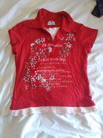T-shirt vermelha com florzinhas foto 1