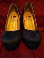Sapatos altos de caramursa foto 1