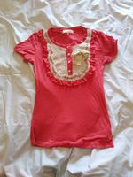 T-shirt cor-de-rosa com renda foto 1