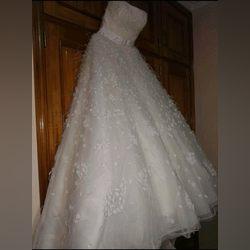 Vendo vestido de noiva Inclui véu e saiote foto 1