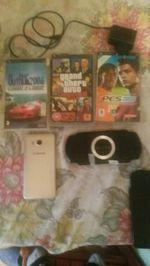 Vendo PSP com 4 Jogos e com cartão de memória de 4 foto 1
